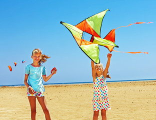 Kid flying kite outdoor.