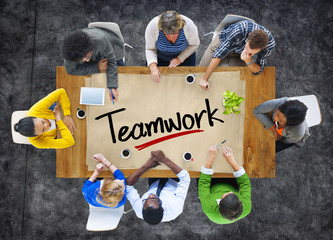 People in a Meeting and Single Word Teamwork