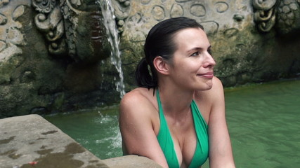 Woman relaxing in hot springs in Bali, super slow motion, 240fps