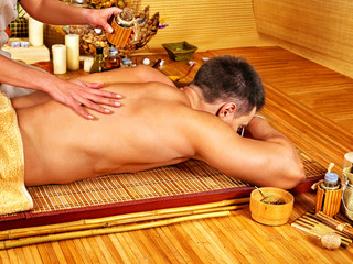 Man getting aroma massage in spa.