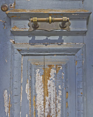 house entrance, old worn door and bronze handle detail
