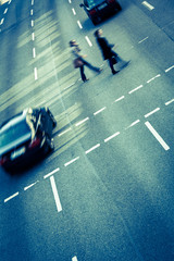 City business people crossing a street - motion blurred abstract