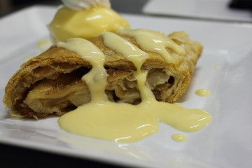 Apple Strudel with hot vanilla sauce
