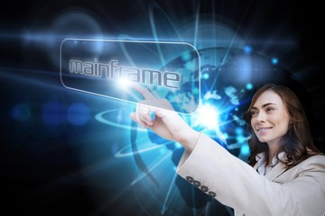 Businesswoman pointing to word mainframe