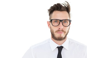 Geeky young businessman looking at camera