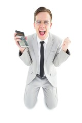 Geeky cheering businessman holding calculator