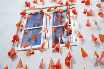 orange flags against white wall