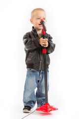 little singer boy singing through a microphone