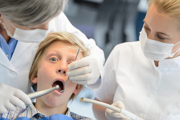 Dentist assistant check teeth teenager boy patient