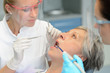 Dental team checkup elderly patient woman teeth