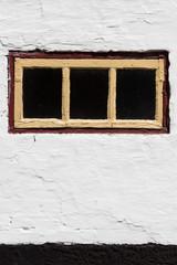 Rustikale Wand mit Fenster