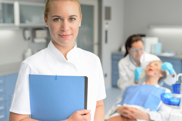 Dental assistant dentist checkup woman patient