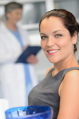 Elegant woman patient at dentist surgery smiling