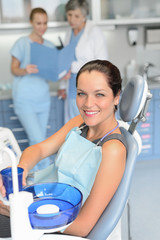 Woman patient sitting chair dental surgery checkup
