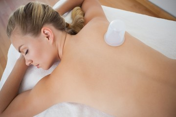 Pretty blonde with vacuum cup on her back