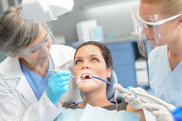 Woman patient dental check dentist team