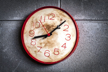 Clock with hands locked by a nail as a symbol of wanting to stop