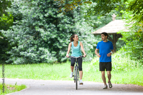 canvas print picture Young sportive couple jogging at the park