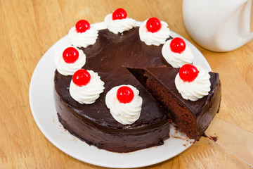 chocolate cake with red Jelly on top