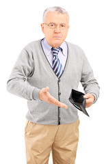 Senior gentleman holding an empty wallet