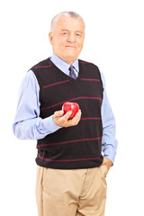 Joyful mature man holding an apple