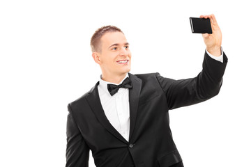 Elegant man taking a selfie with cell phone