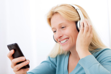 Portrait of a young attractive woman listenning music