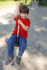 Kid sit on swing rope