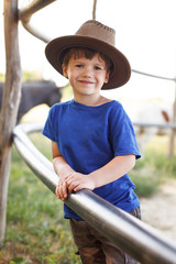 Little happy caucasian boy on farm