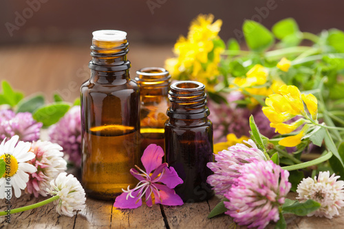 Leinwandbild Motiv essential oils and medical flowers herbs