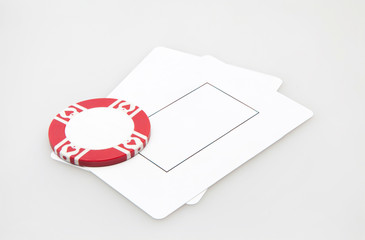 Two blank play cards with casino chip