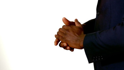 Businessman clapping hands on white background