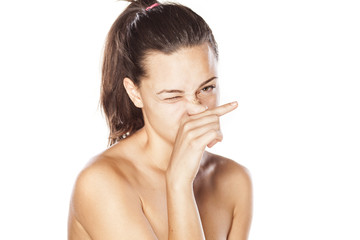 young girl rubs her nose