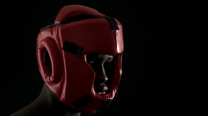 Tough boxer wearing red helmet