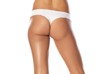 beautiful women 's buttocks and hips in white thongs
