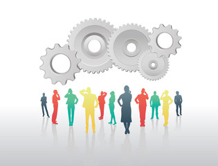 Business people standing under cogs and wheels