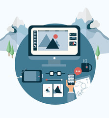 Designers desk on background of snowy mountains