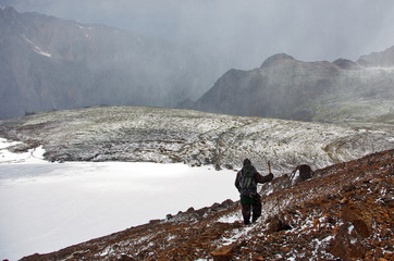 man in the background of the valley during a snowfall, Aktru