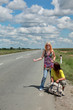 Hitch hiking teenage couple, boy and girl at road