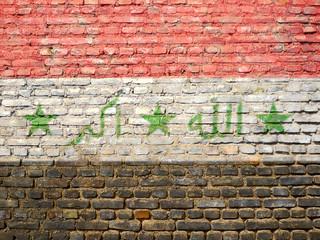 drapeau irakien peint sur un mur
