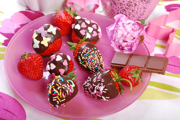 chocolate covered fresh strawberries  with colorful sprinkles