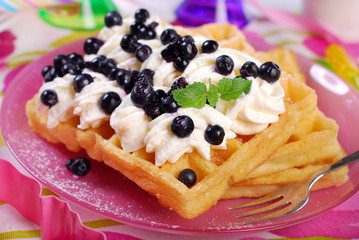 waffles with whipped cream and blueberries