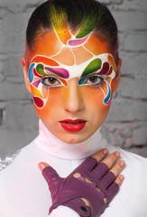 Portrait of a model with bright creative make up