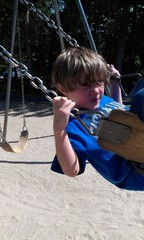 Boy swinging with funny face