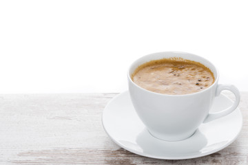 cup of espresso on a white table and space for text