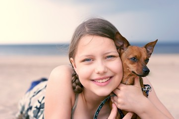 Teen girl with her puppy