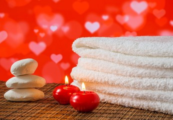 Spa massage with towel stacked candles and stone,valentine day