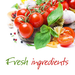 Italian food ingredients - fresh cherry tomato, basil and pasta
