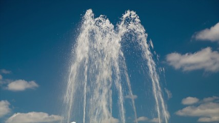 Fountain closeup in summer on a background of blue sky