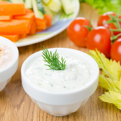 yoghurt sauce with herbs to assorted fresh vegetables